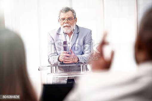 652281870 istock photo businessman speaking at a business conference 504084626