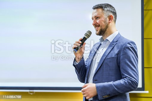 Businessman speaking at a podium in a conference or seminar