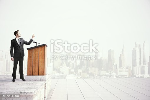 istock Businessman speaking from tribune 527211290