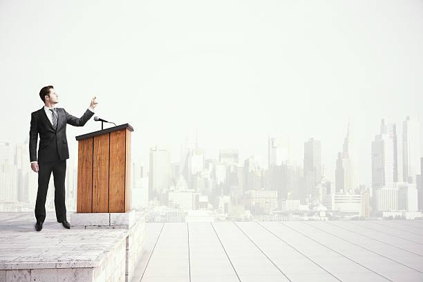Businessman speaking from tribune stock photo