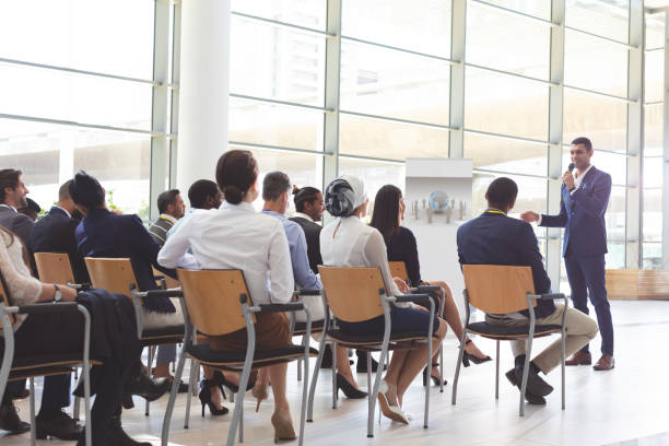 Businessman speaking in a business seminar stock photo