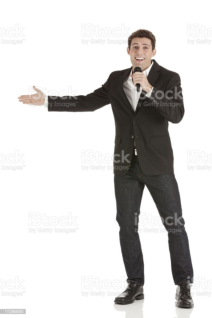 Businessman speaking into a microphone royalty-free stock photo