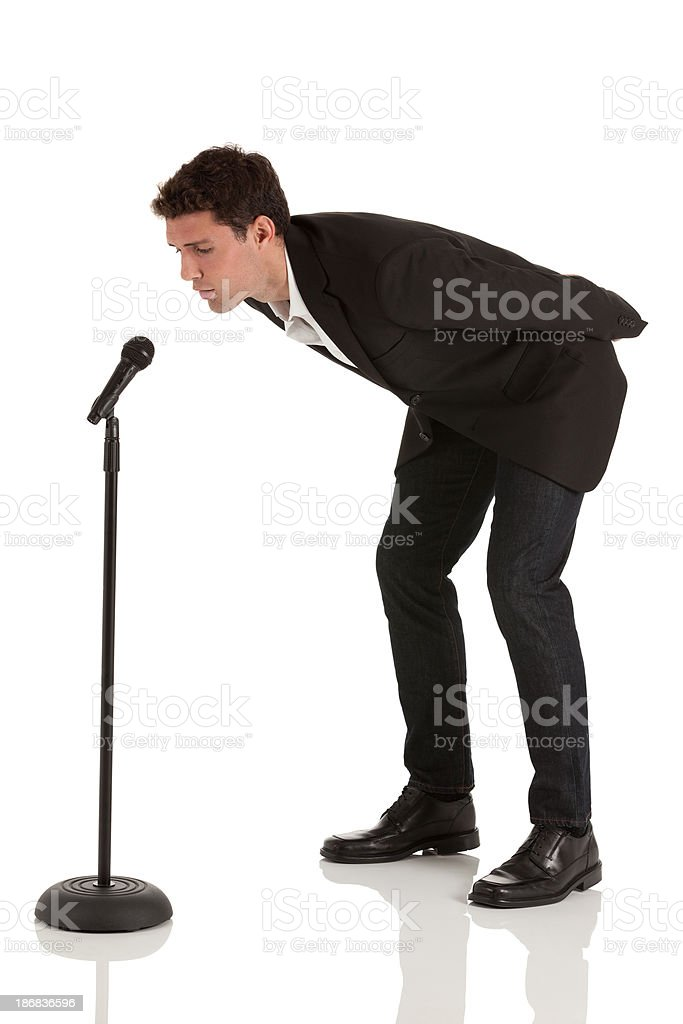 Businessman speaking into microphone stock photo