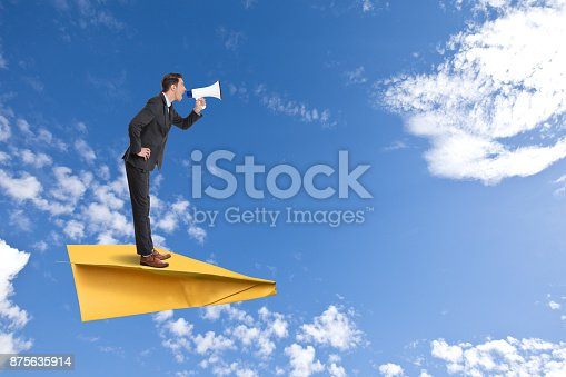 903659714istockphoto Businessman speaking on megaphone 875635914