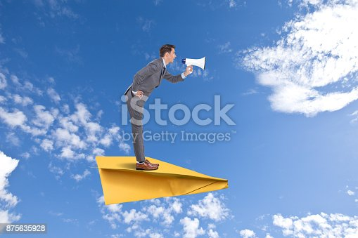 903659714istockphoto Businessman speaking on megaphone 875635928