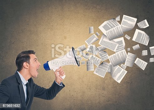 903659714istockphoto Businessman speaking on megaphone 875651632