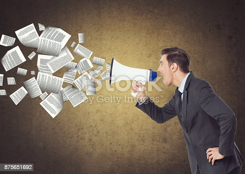 903659714istockphoto Businessman speaking on megaphone 875651692