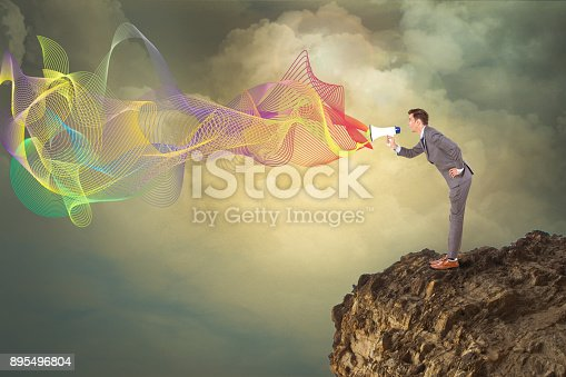 903659714istockphoto Businessman speaking on megaphone 895496804