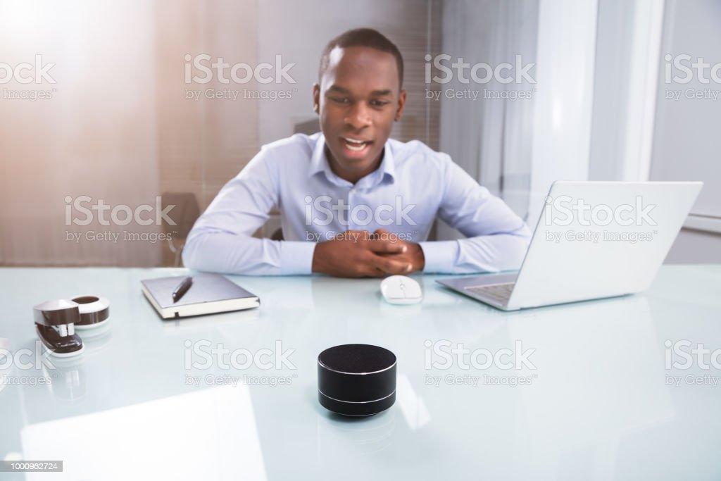 Businessman Speaking On Wireless Speaker royalty-free stock photo