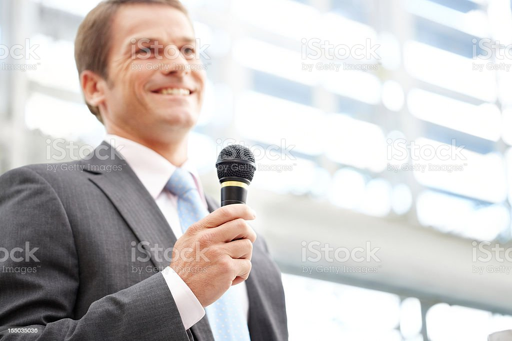 Businessman Speaking With a Microphone royalty-free stock photo