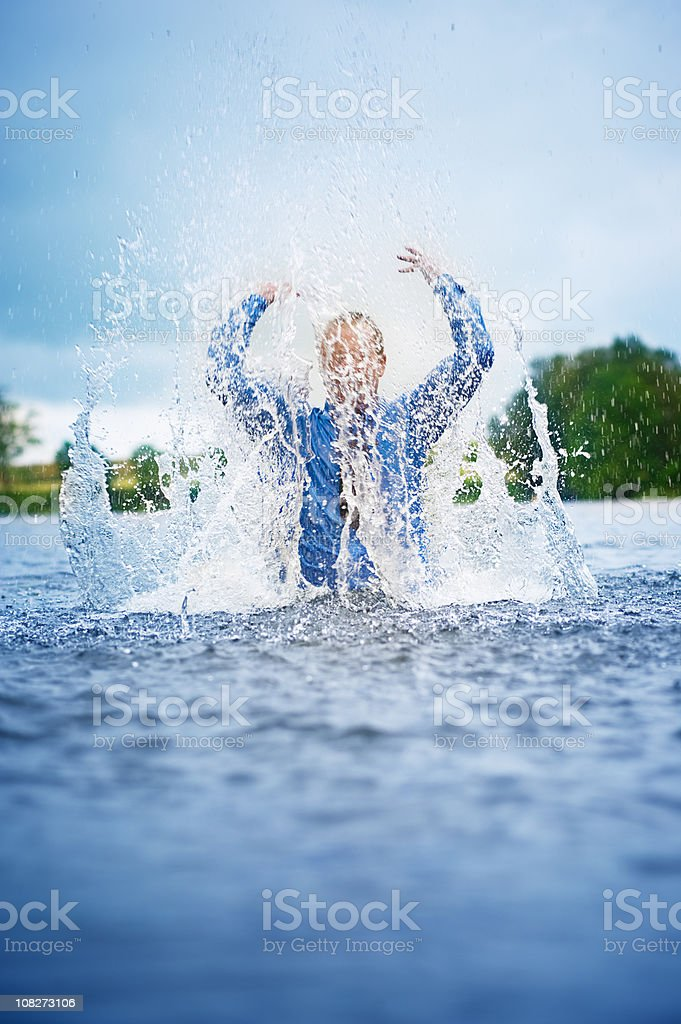 Businessman splashing a lot of water in the lake royalty-free stock photo