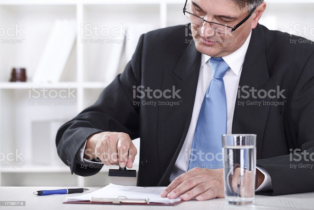 businessman stamping document , approve contract stock photo