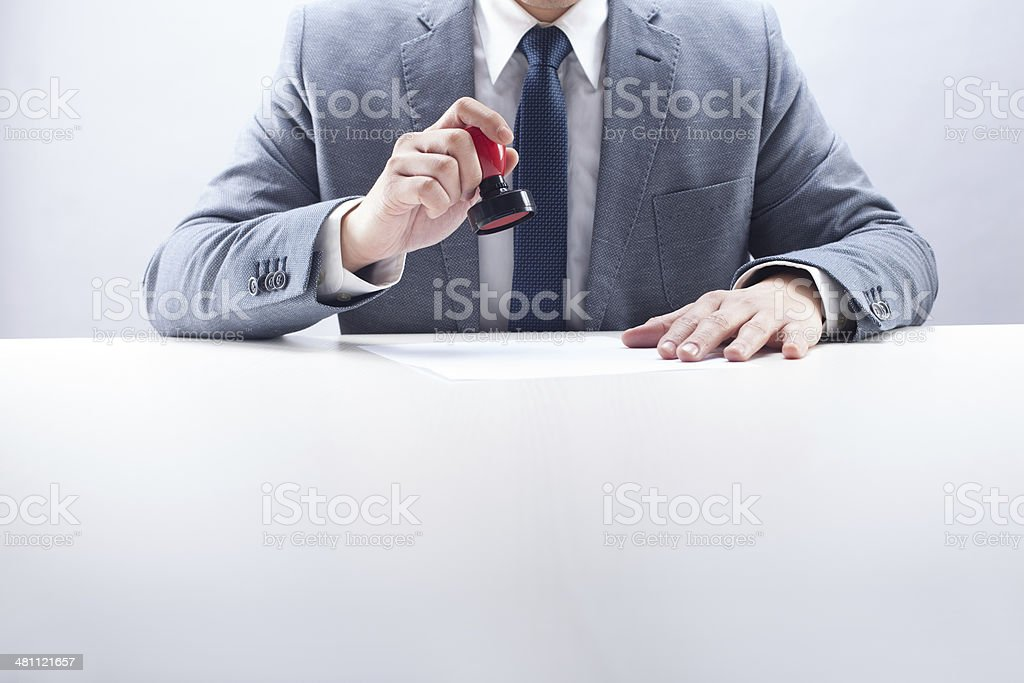 Businessman Stamping the Document stock photo