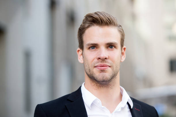 Businessman stand on urban background. Confident man in formal wear outdoor. This is my city. Male grooming for ceo at barbershop. Thinking about new possibilities. Confidence and charisma stock photo