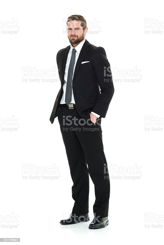 Businessman standing and looking at camera stock photo