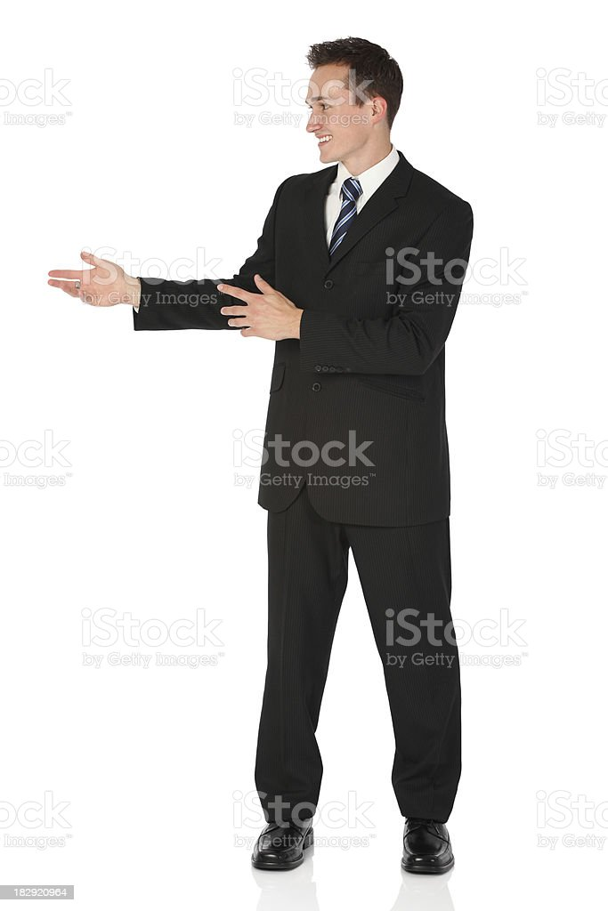 Businessman standing and smiling royalty-free stock photo