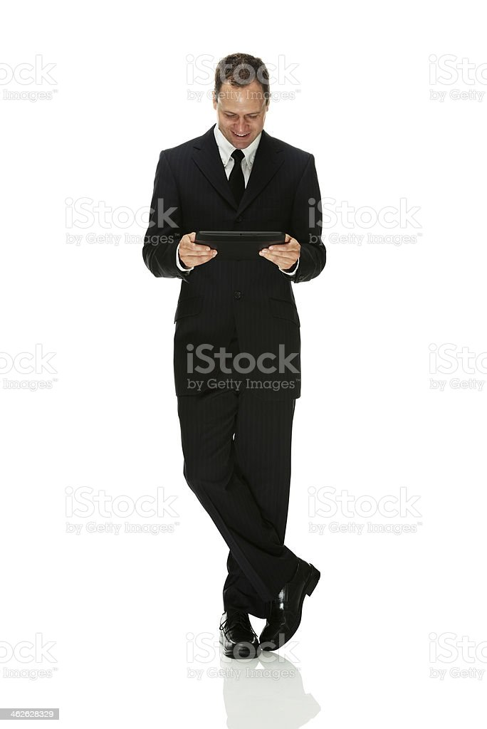 Businessman standing and using tablet royalty-free stock photo