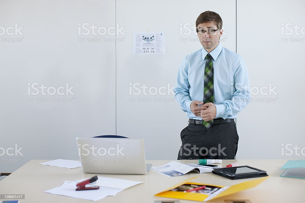Businessman standing at conference desk royalty-free stock photo