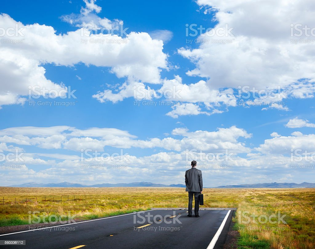 Businessman Standing At End Of The Road stock photo