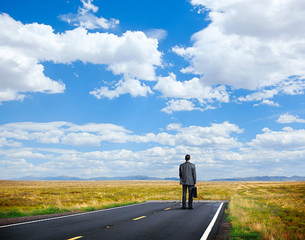 Businessman Standing At End Of The Road - Photo
