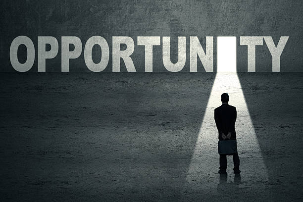 businessman standing at opportunity door - opportunity stock photos and pictures