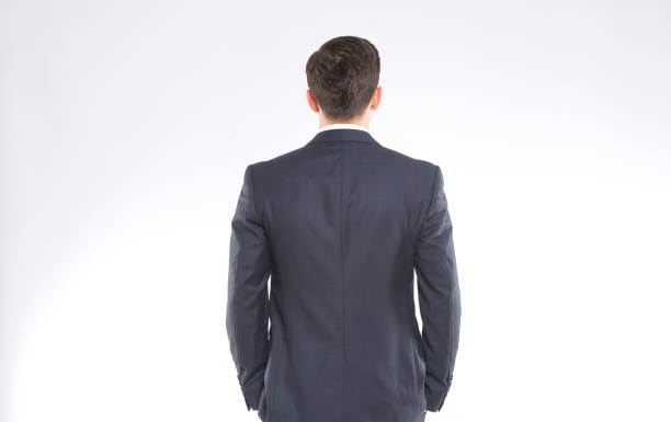 A businessman standing backwards A businessman standing backwards wearing a suit bending over backwards stock pictures, royalty-free photos & images