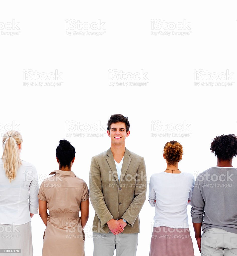 Businessman standing between colleagues against white background royalty-free stock photo