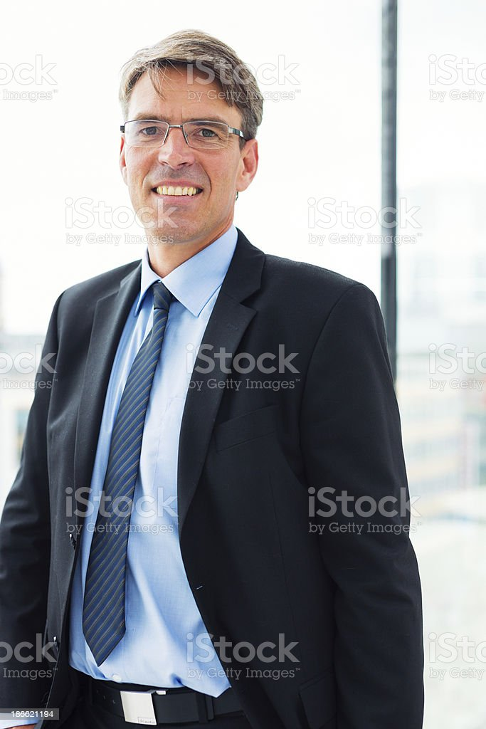 businessman standing by the window royalty-free stock photo