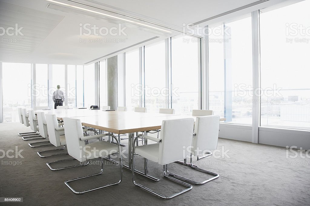 Businessman standing in conference room royalty-free stock photo