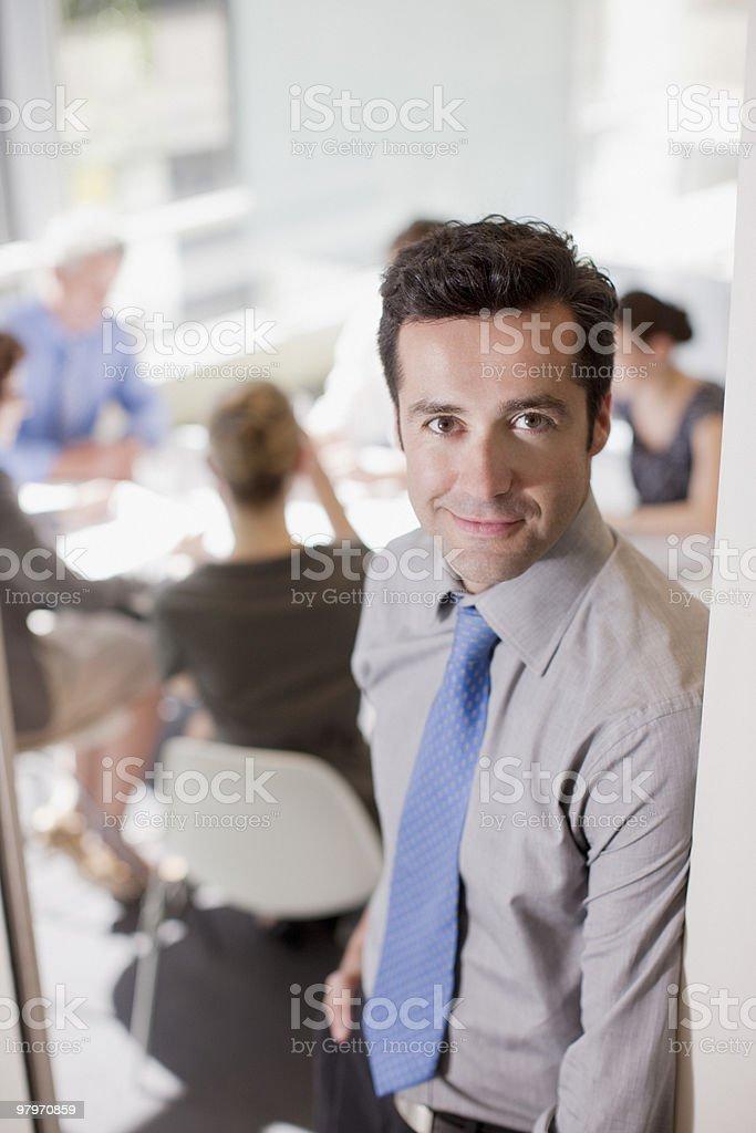 Businessman standing in doorway of meeting royalty-free stock photo