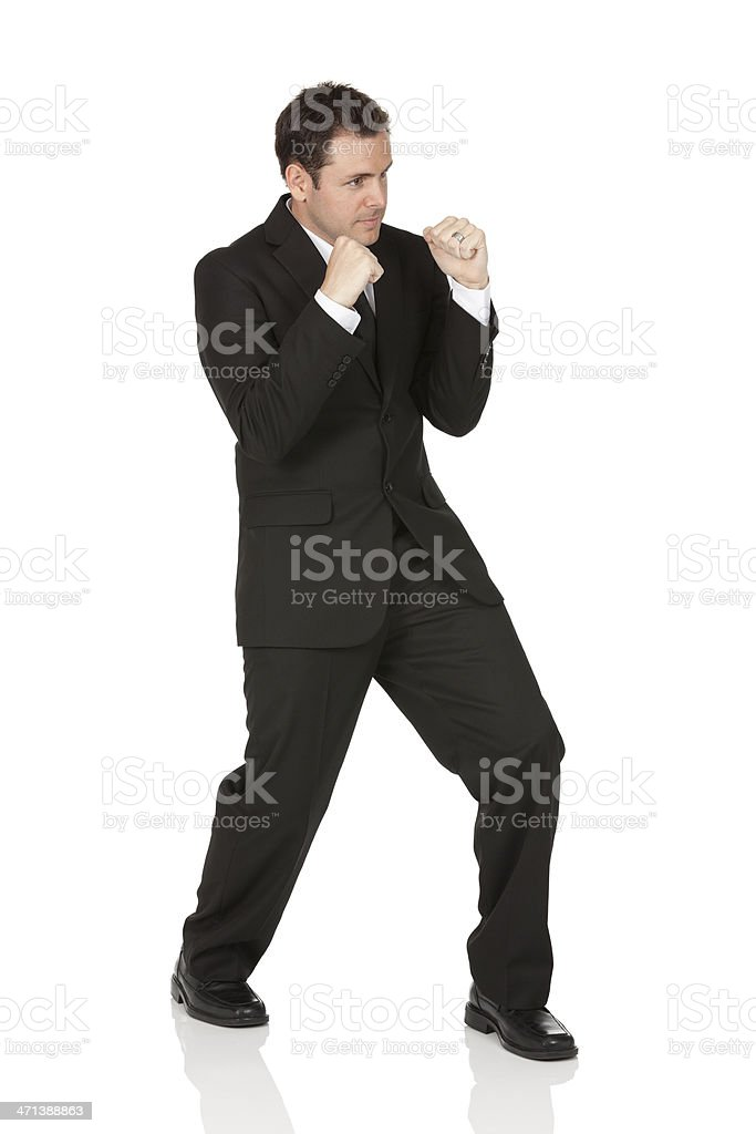 Businessman standing in fighting pose stock photo