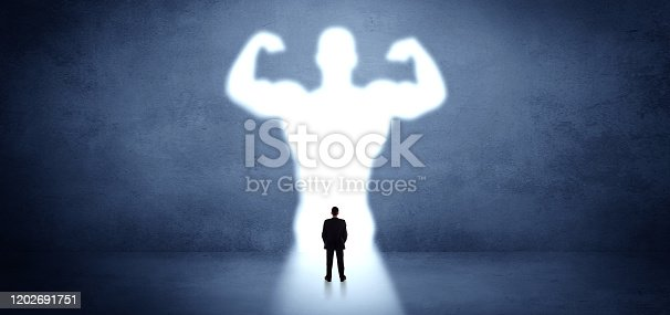 Businessman standing and dreaming about a strong superhero