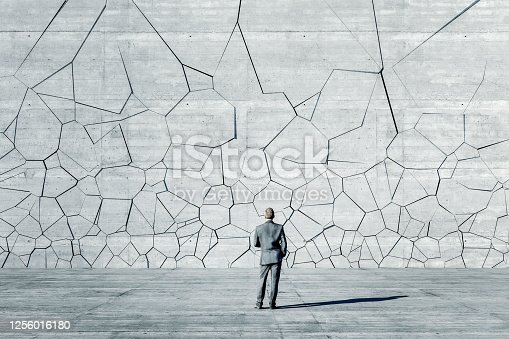 Businessman standing in front of breaking wall. This is entirely 3D generated image.