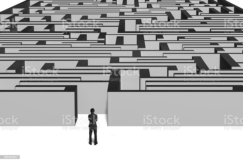 Businessman standing in front of maze royalty-free stock photo