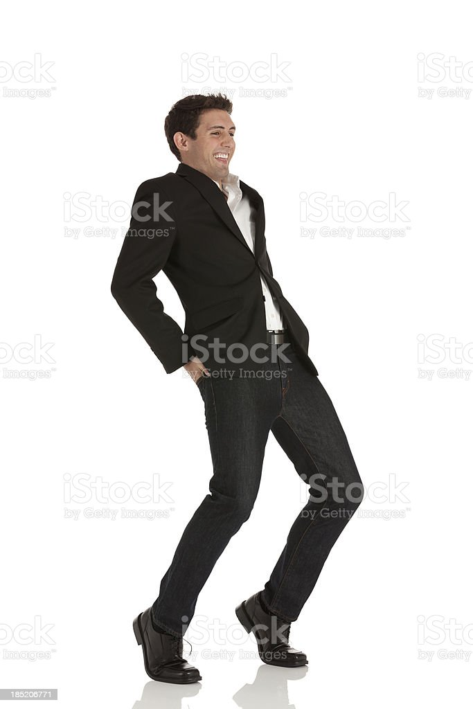 Businessman standing in funny pose stock photo