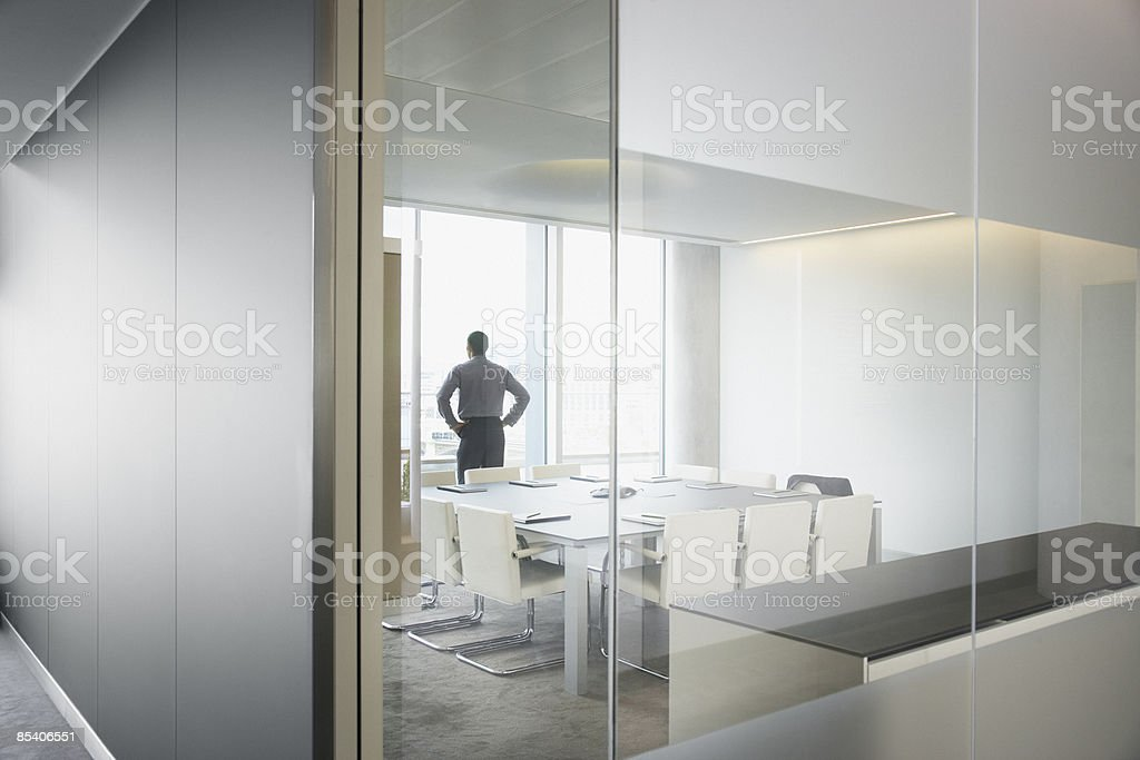 Businessman standing in modern conference room royalty-free stock photo