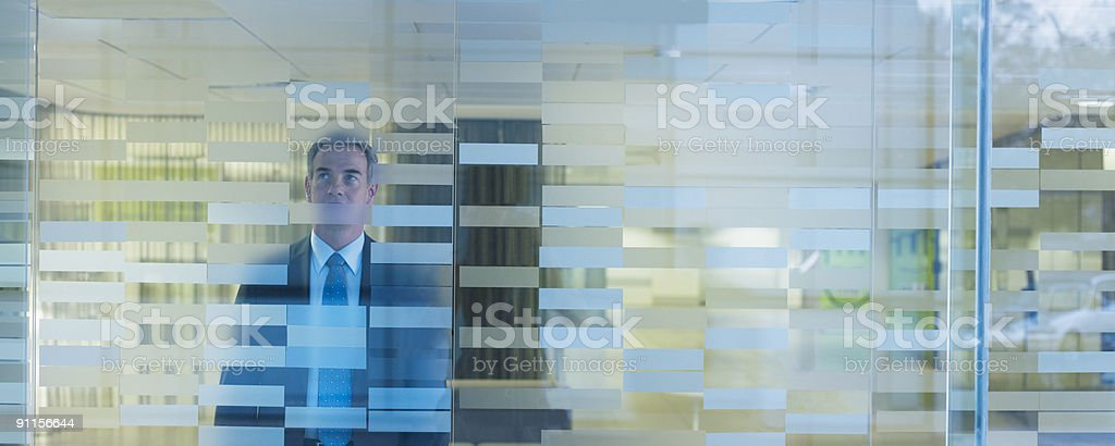 Businessman standing in modern office royalty-free stock photo