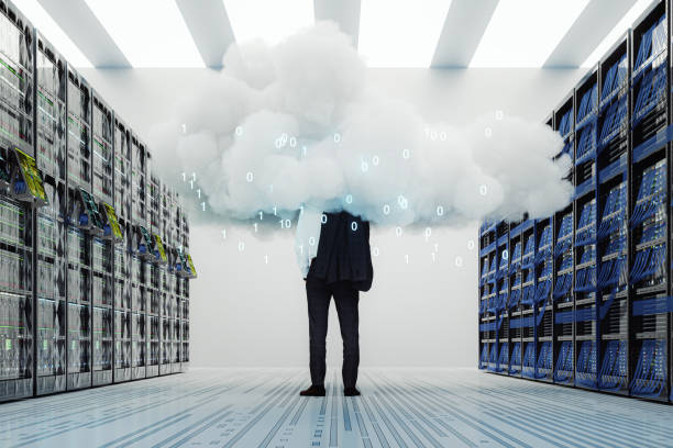 Businessman standing in server room stock photo