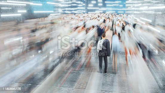 Businessman standing in the fast moving crowds of commuters. This is entirely 3D generated image.
