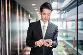 istock businessman standing in the office corridor 543662066