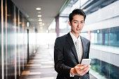 istock businessman standing in the office corridor 543662114