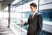 istock businessman standing in the office corridor 543662174