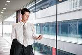 istock businessman standing in the office corridor 543662228