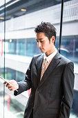 istock businessman standing in the office corridor 543692120