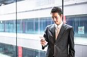 istock businessman standing in the office corridor 543692220