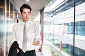 istock businessman standing in the office corridor 543692316