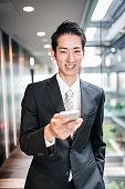 istock businessman standing in the office corridor 609088738