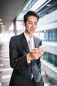 istock businessman standing in the office corridor 609088872