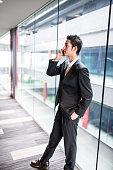istock businessman standing in the office corridor 609089546