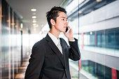 istock businessman standing in the office corridor 609089672